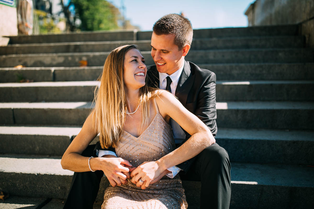 couple smiling on steps