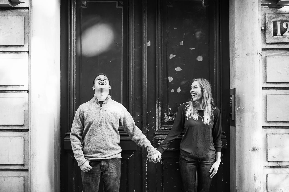 couple laughing in parisian doorway