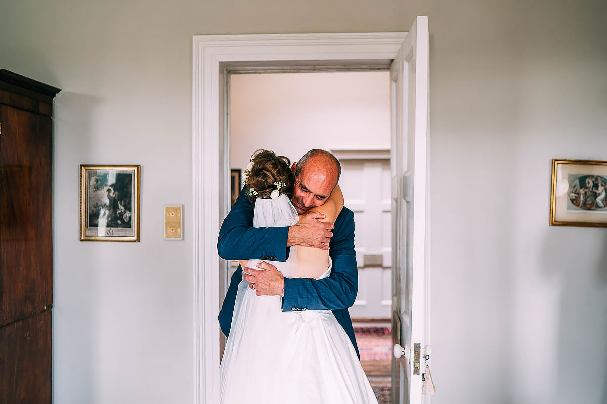 bride and her dad hug