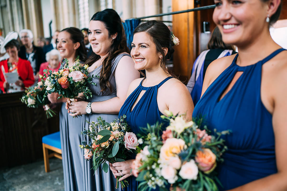 bridesmaids looking proud