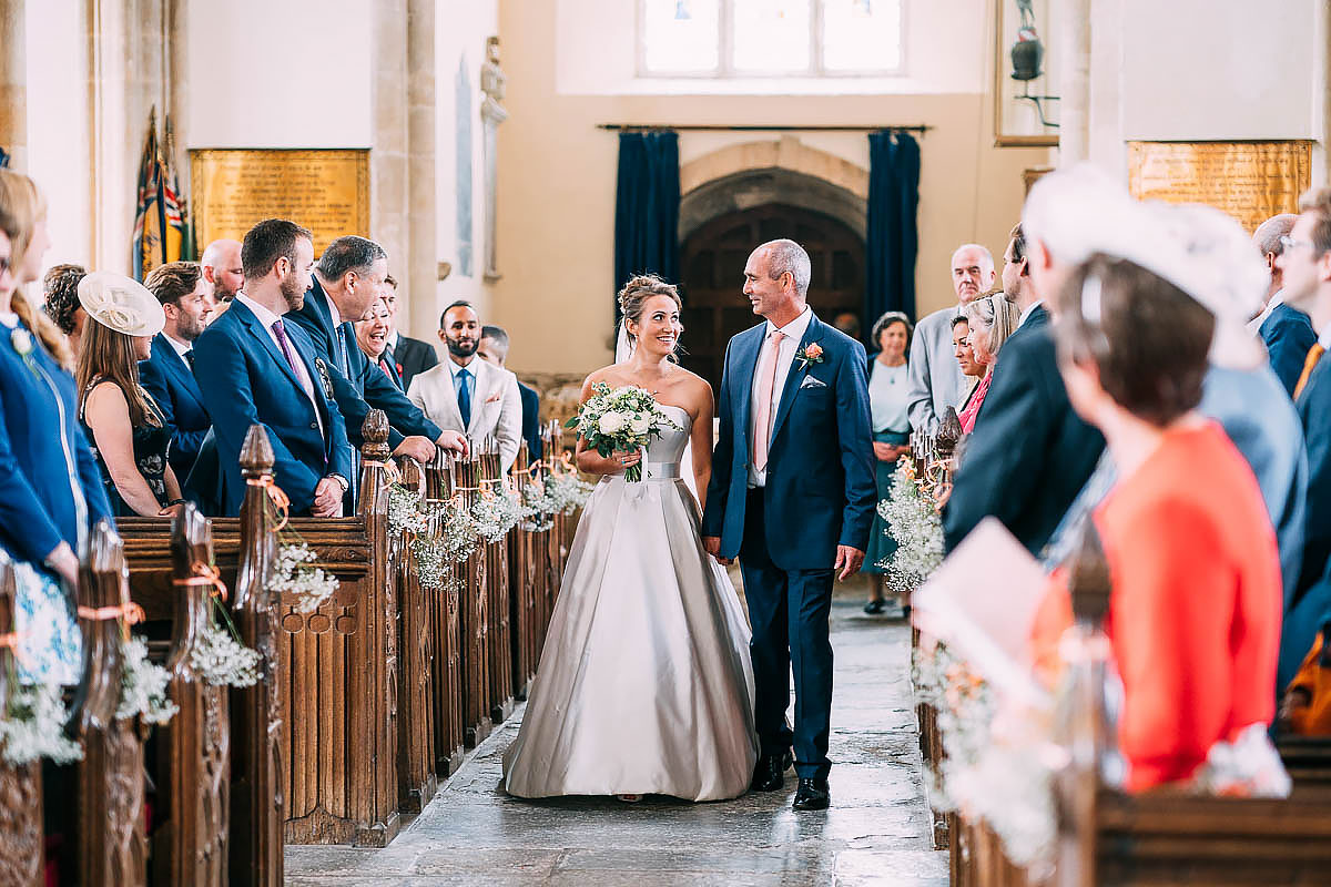 bride walking down church aisle at North Cadbury Court