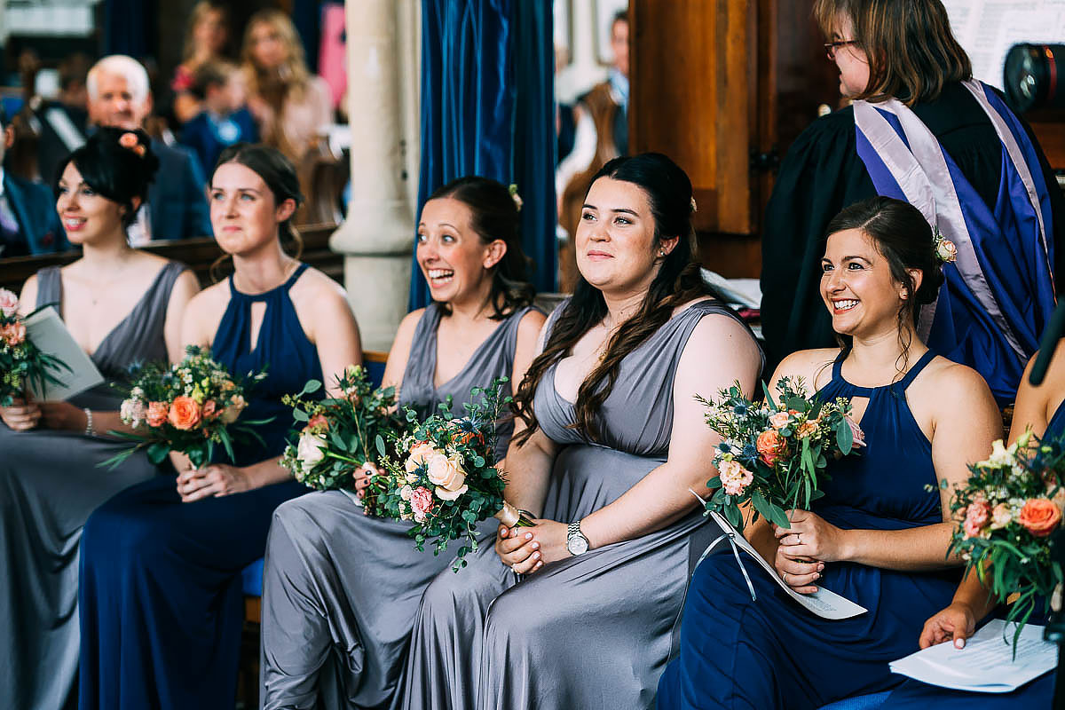 bridesmaids in blue at wedding ceremony