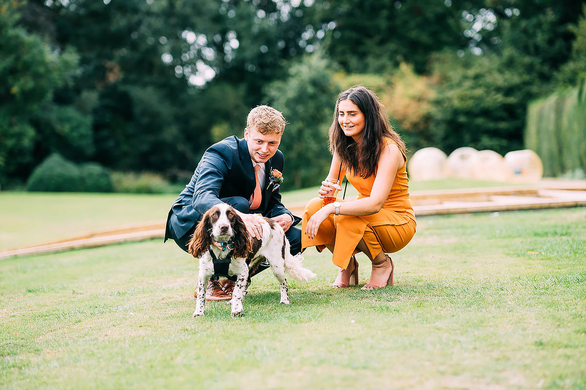 hugging the dog at a wedding