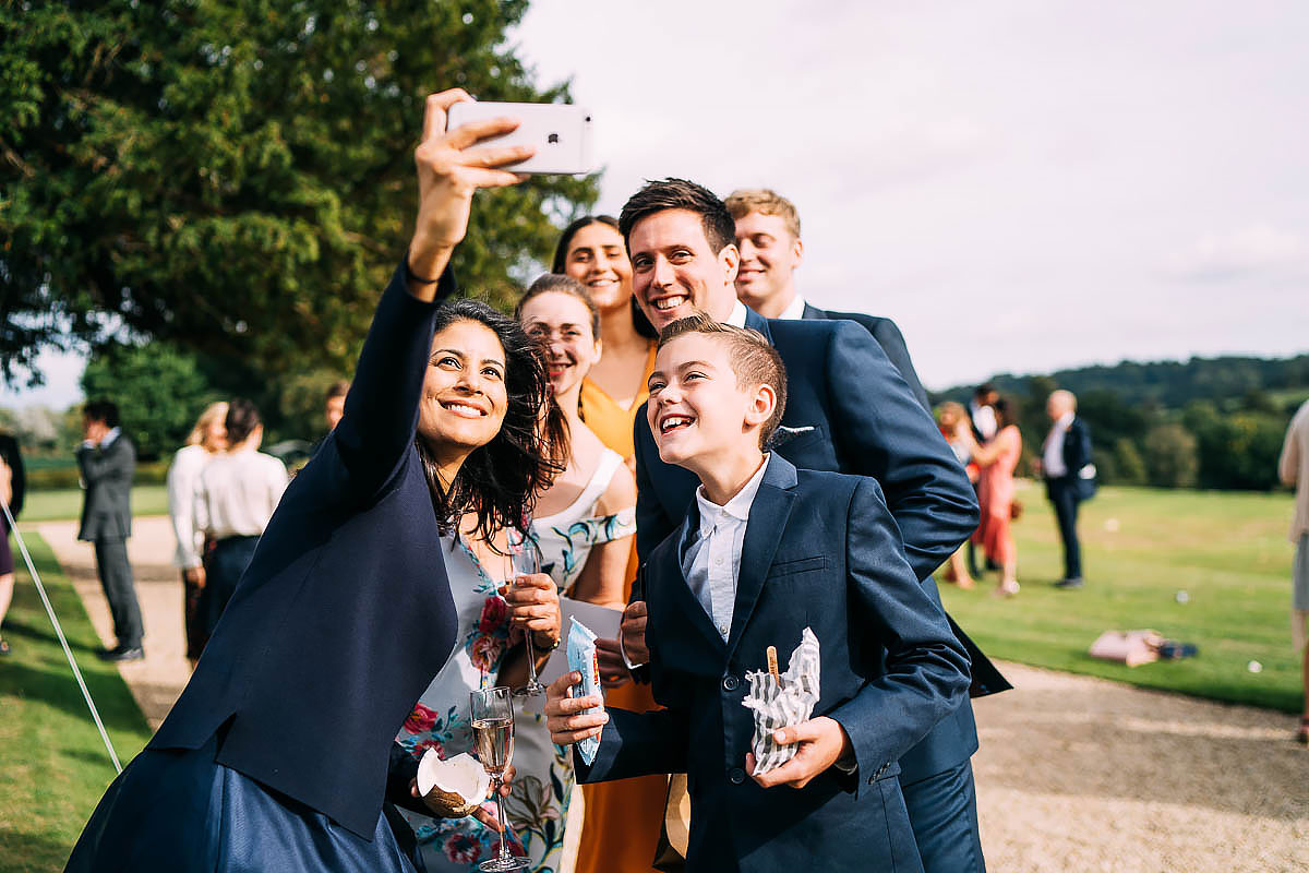 wedding guests taking a selphie