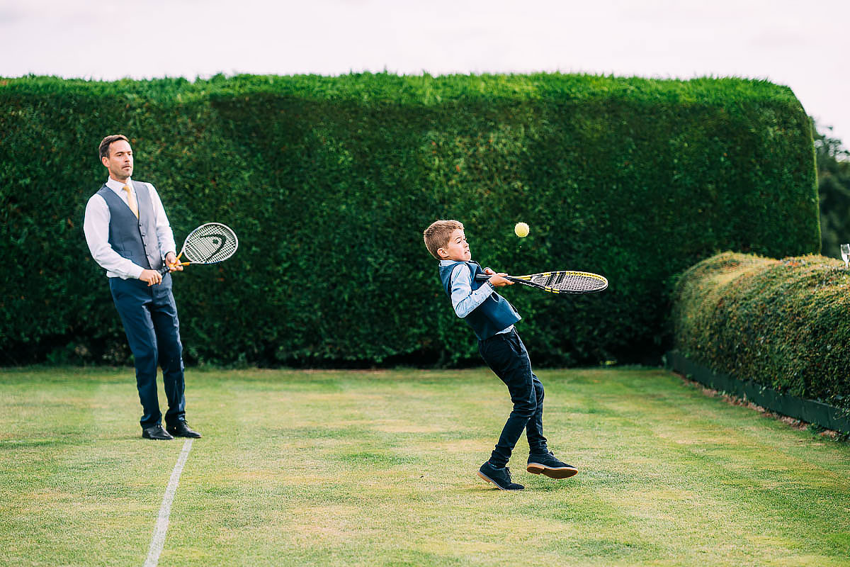 playing tennis during the wedding reception