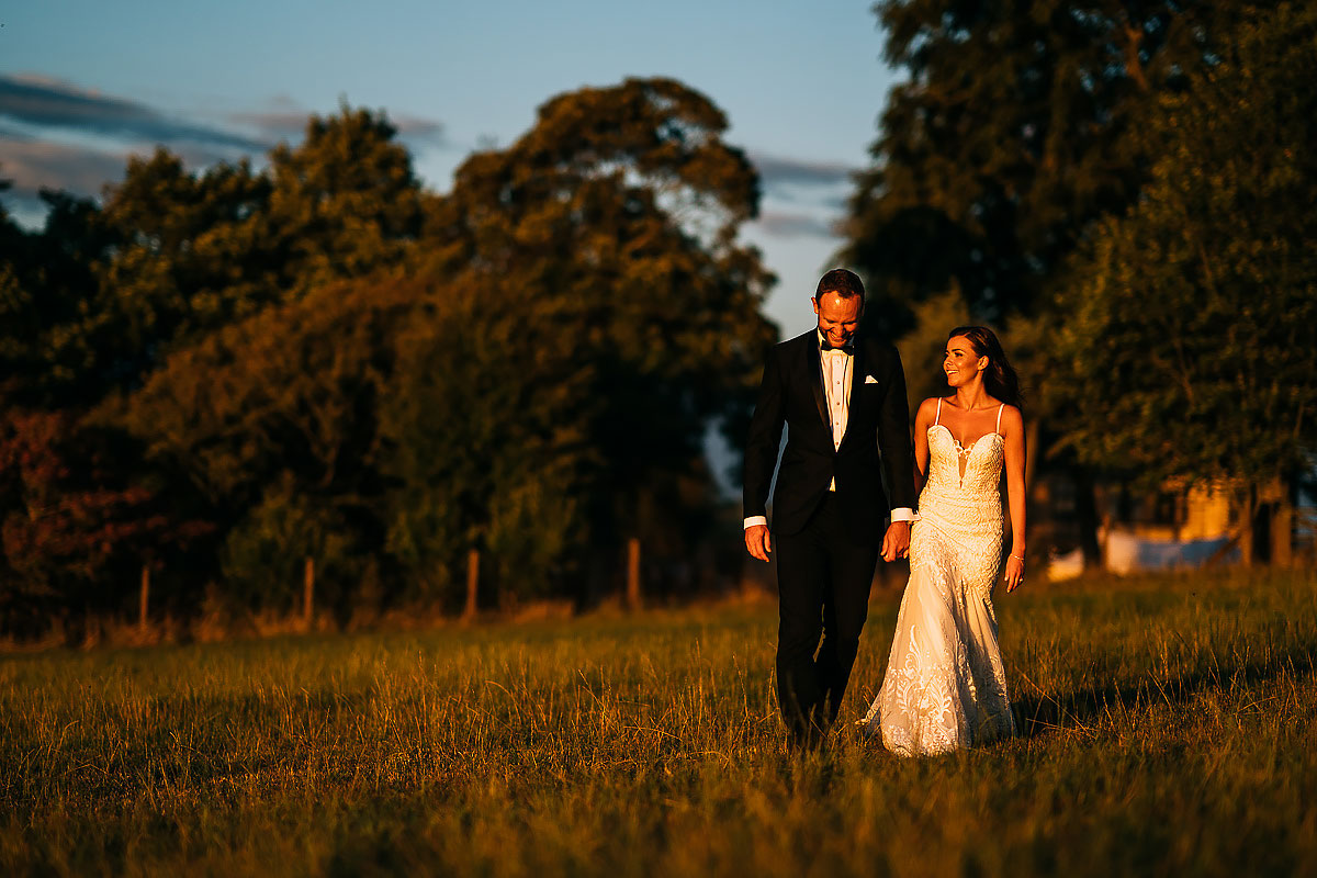 couple walking in a field