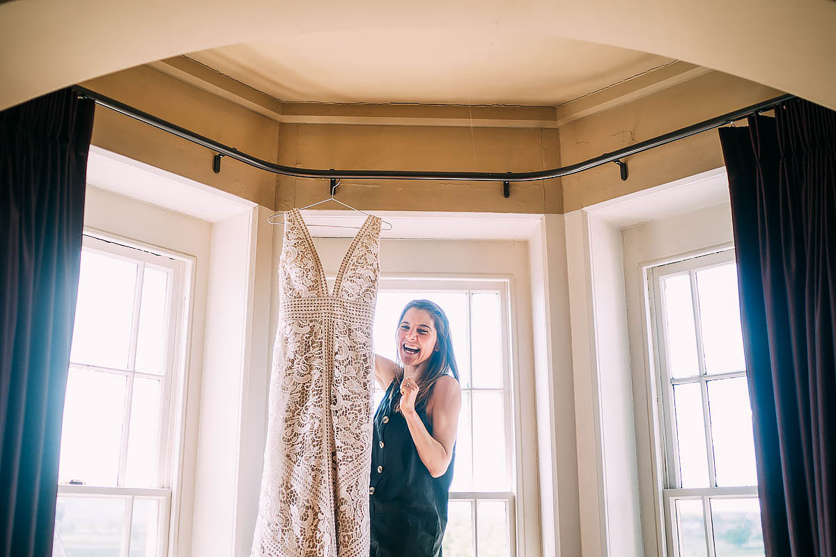 hanging wedding dress in window of battleaxes