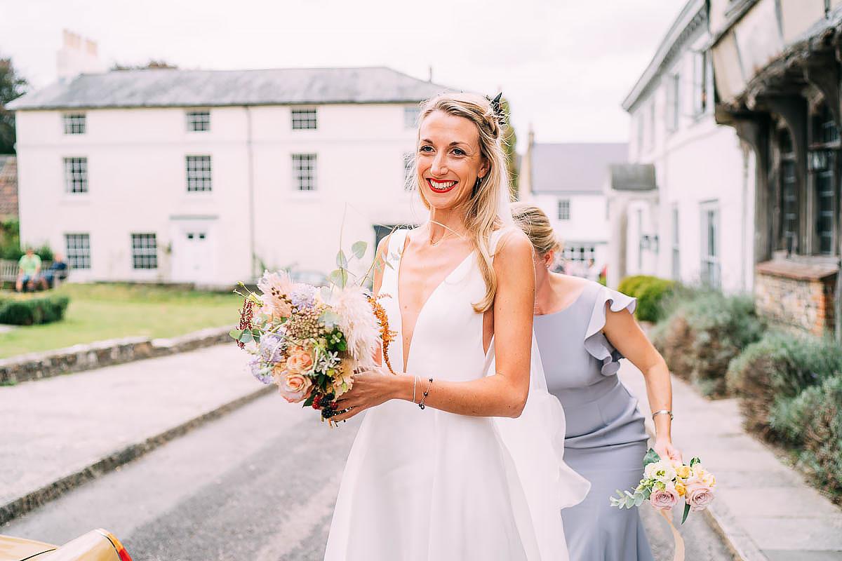 bride arriving at wedding at Cerne Abbas church