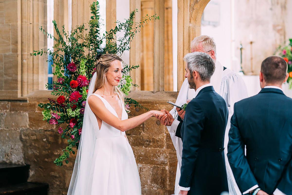 wedding ceremony inside Cerne Abbas church