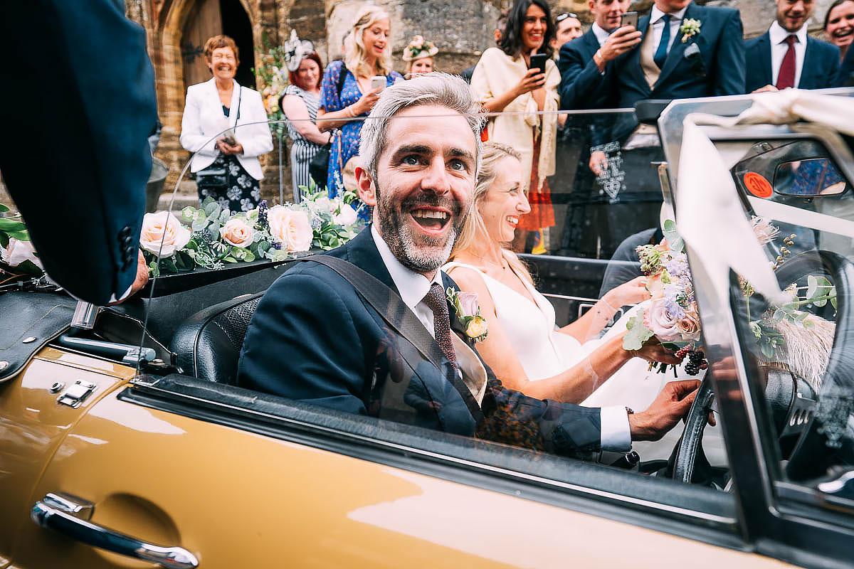 confetti over the wedding car