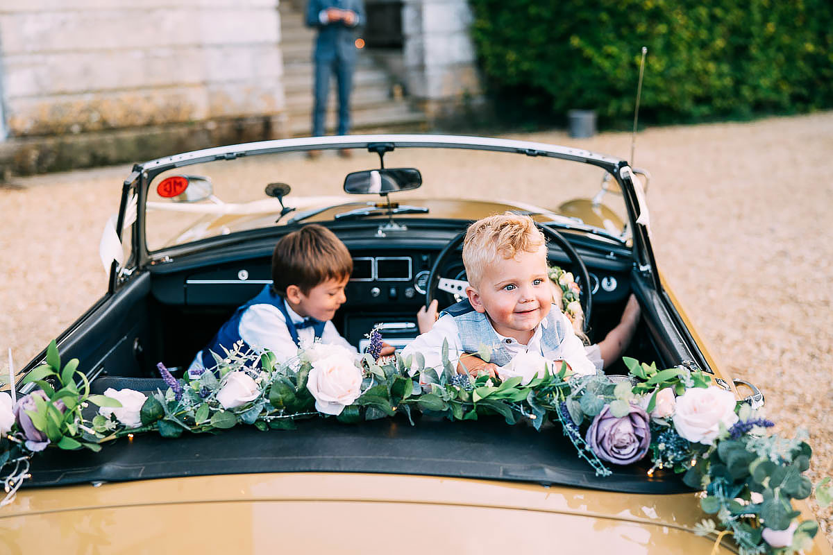 in in classic car at wedding