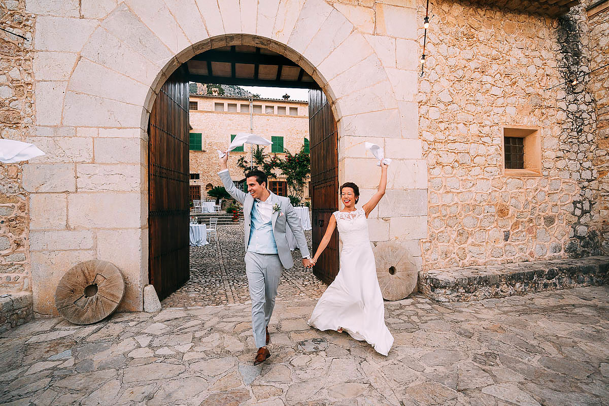 bride and groom enter wedding at Finca Son Berga