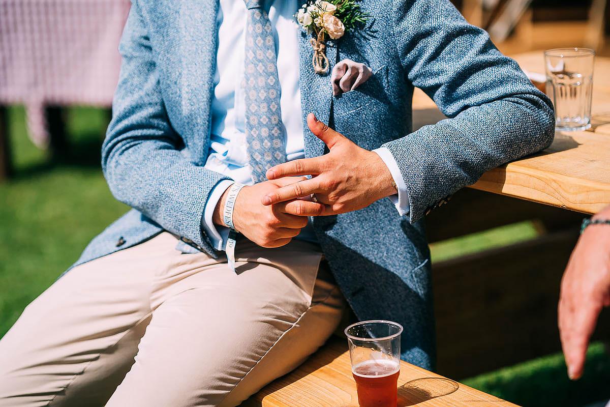 groom touching wedding ring