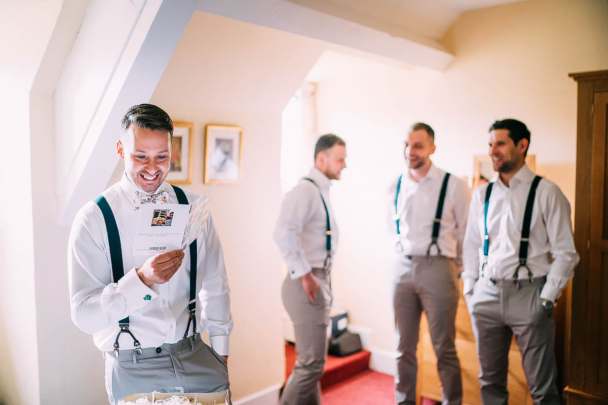 groom getting ready at Knowle Manor