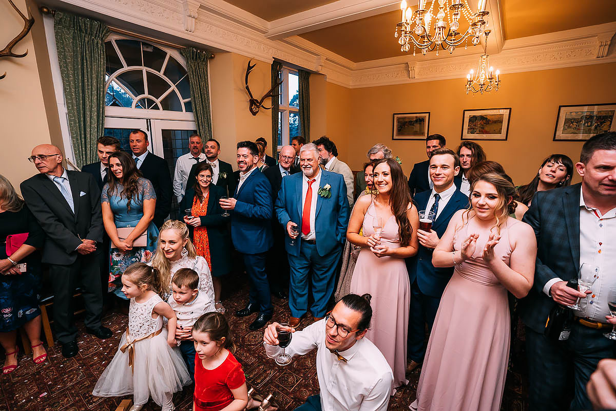 cutting the cake at Coombe lodge wedding