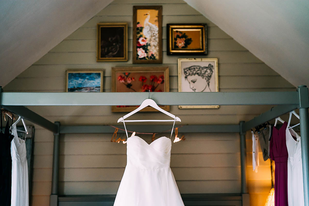 wedding dress hanging up at The Frogmill