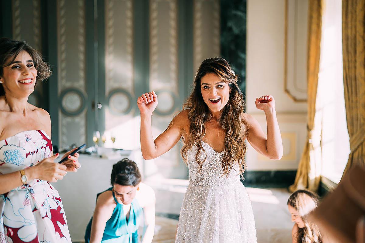 bride gets on wedding dress