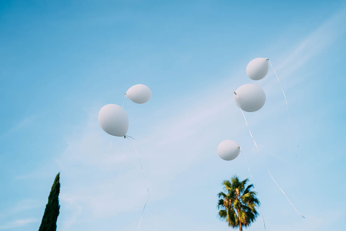 balloons in the sky at wedding