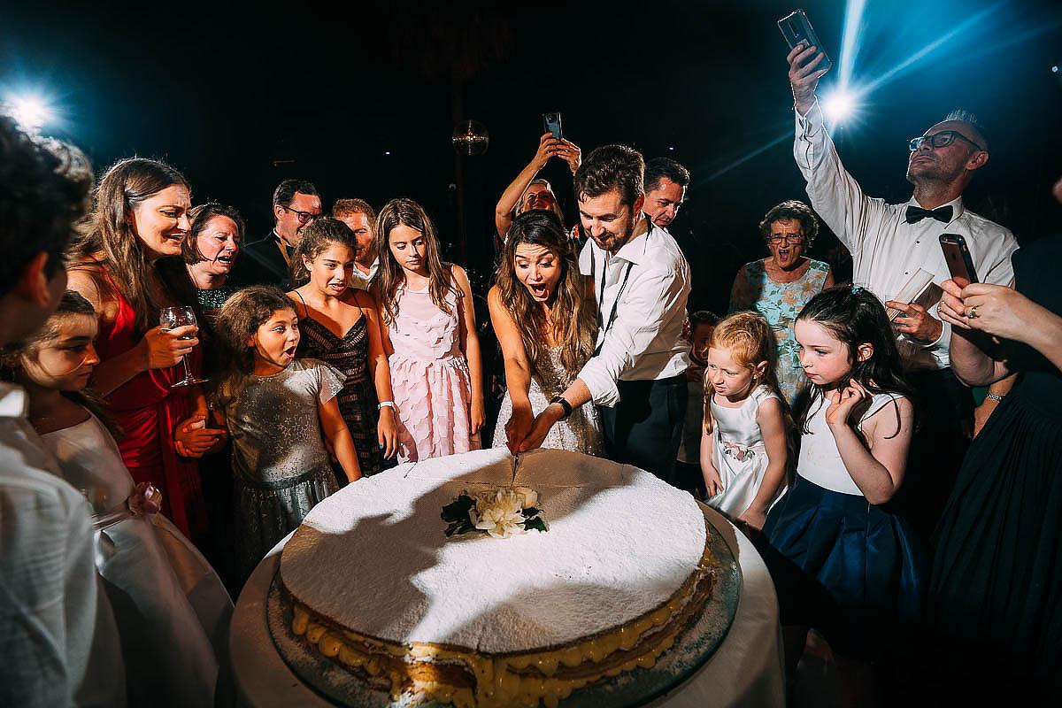 cutting the wedding cake at Villa Miani Wedding