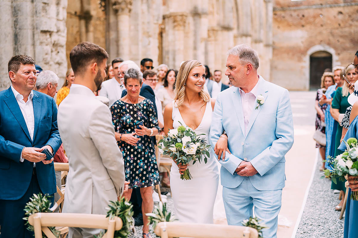 bride walks down the aisle at San Galgano abbey wedding