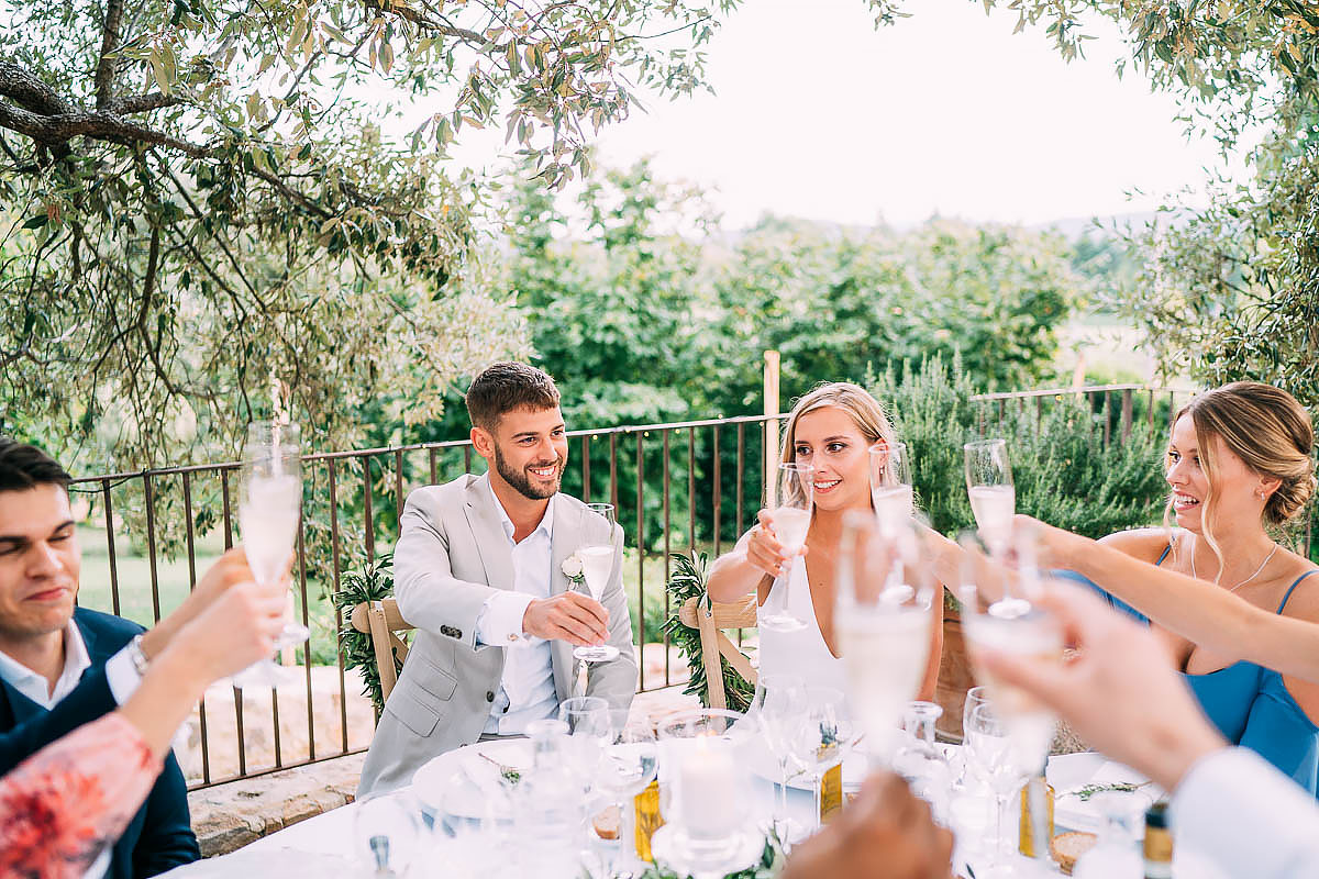 cheers at tuscan wedding