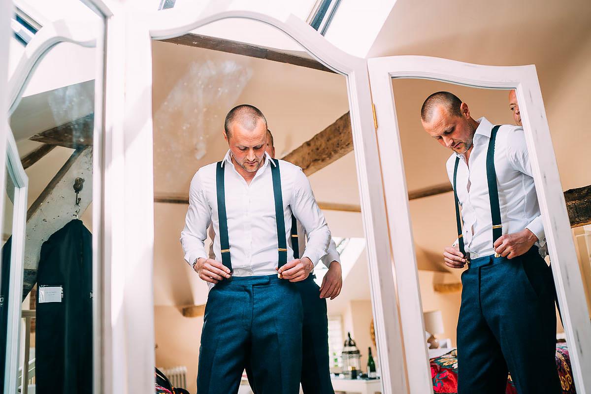 groom getting ready at Gaynes park