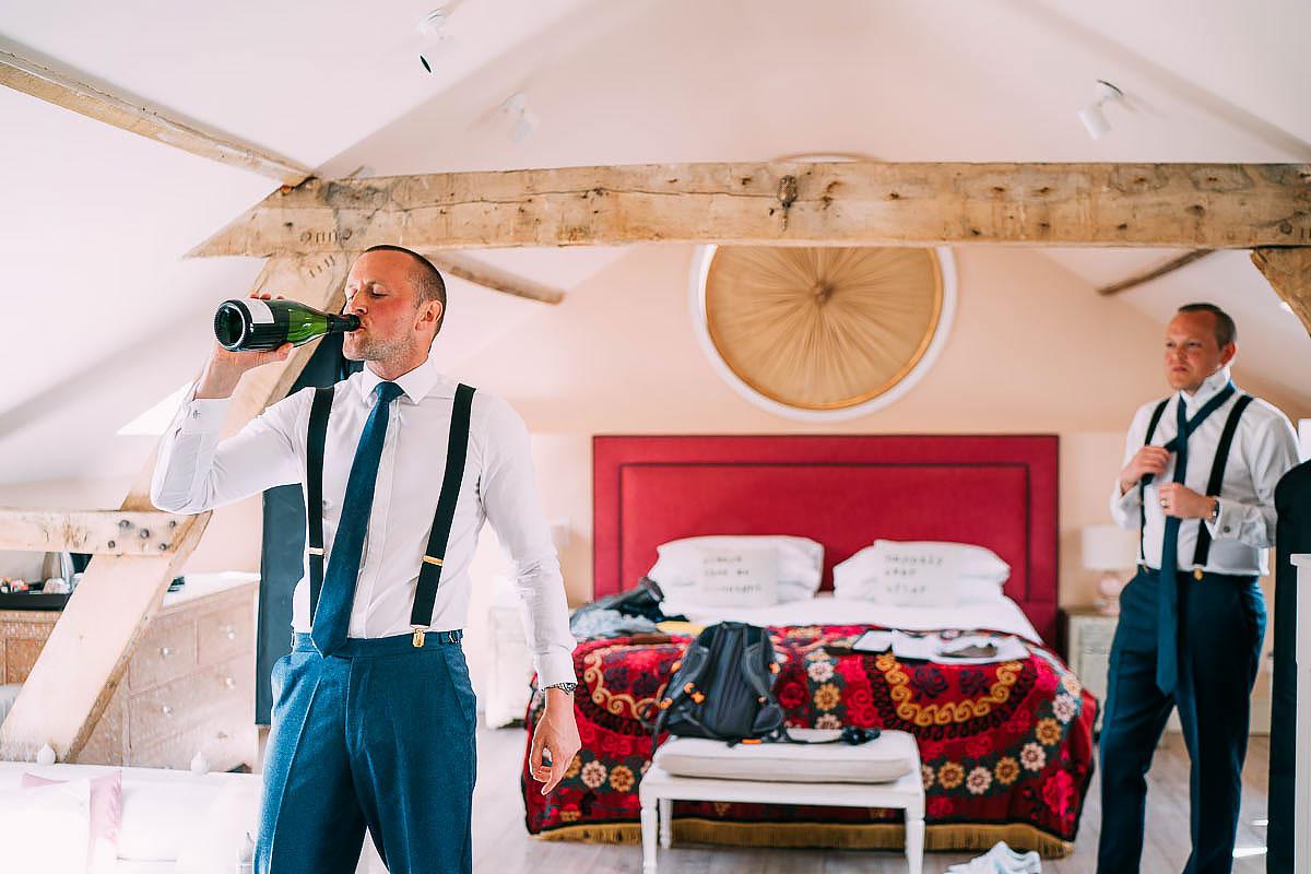 groom drinking from bottle