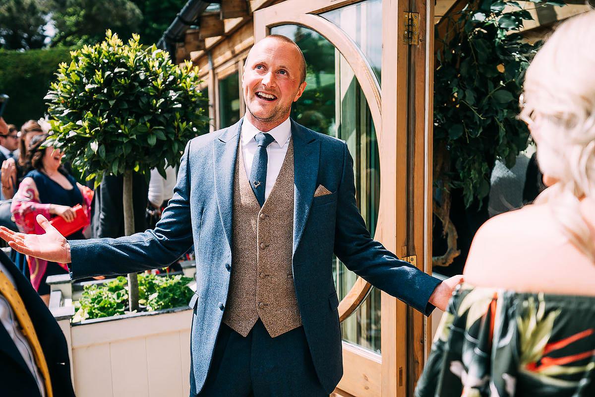 groom celebrating weather