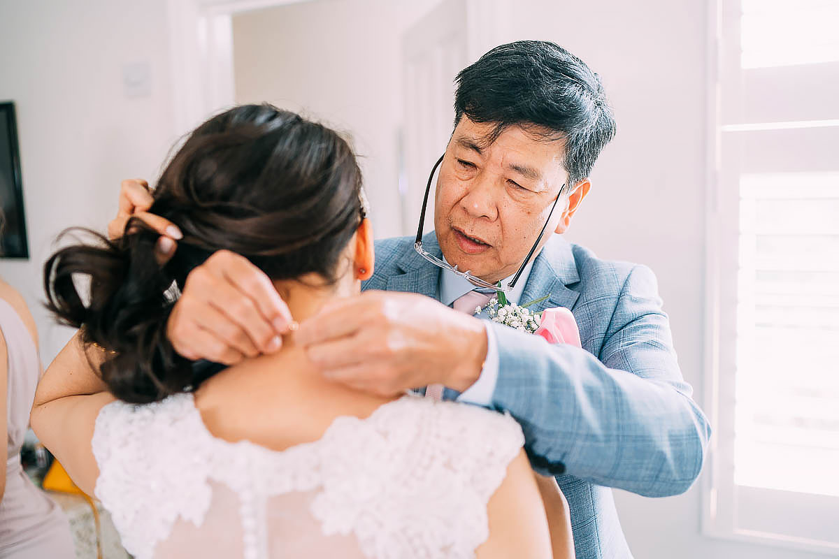 father of the groom giving jewellery