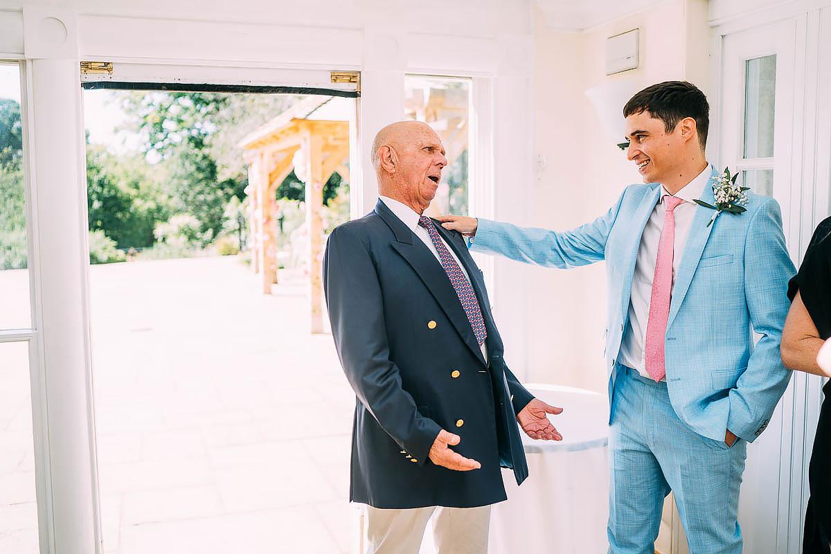 groom welcoming guests