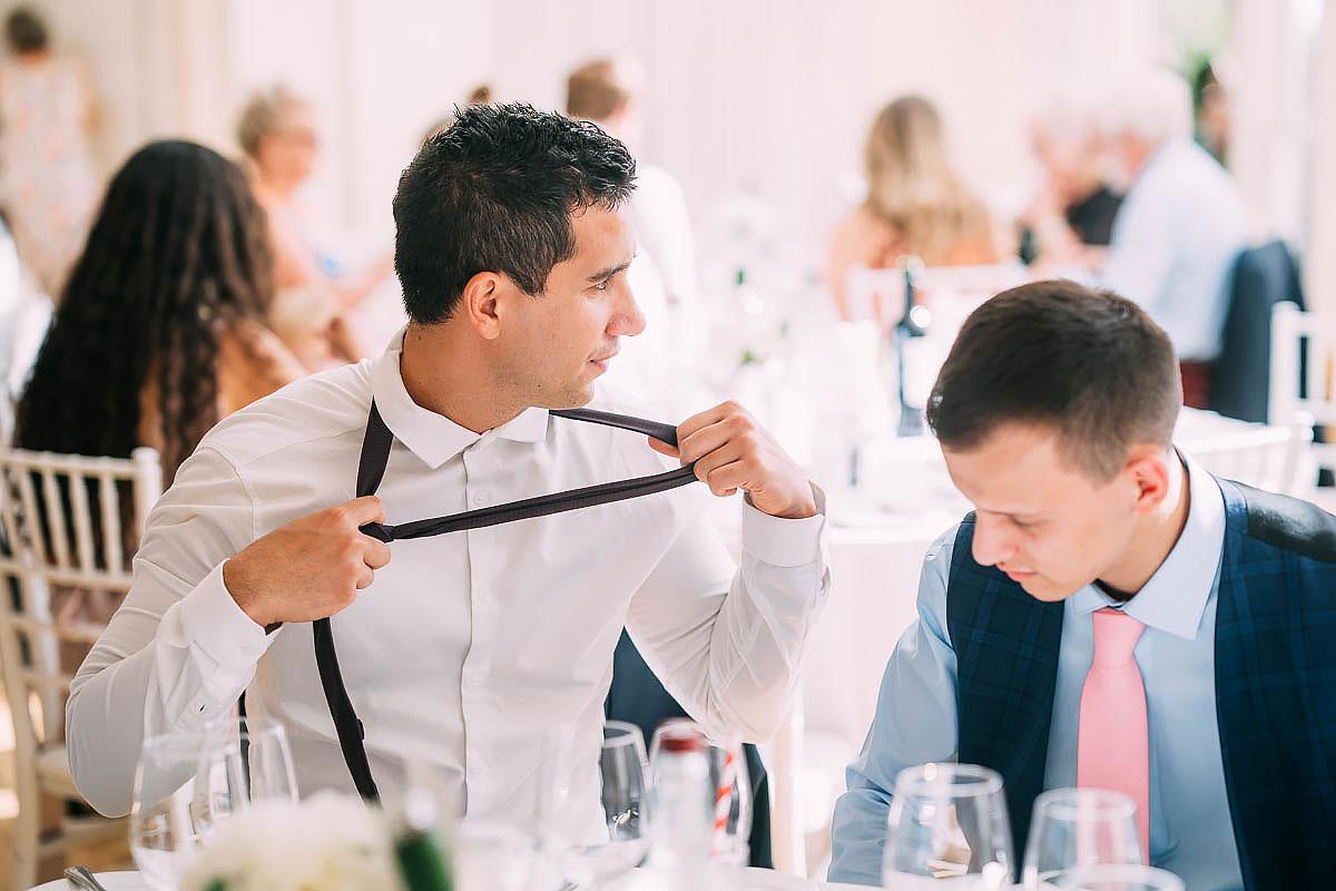 man taking off tie