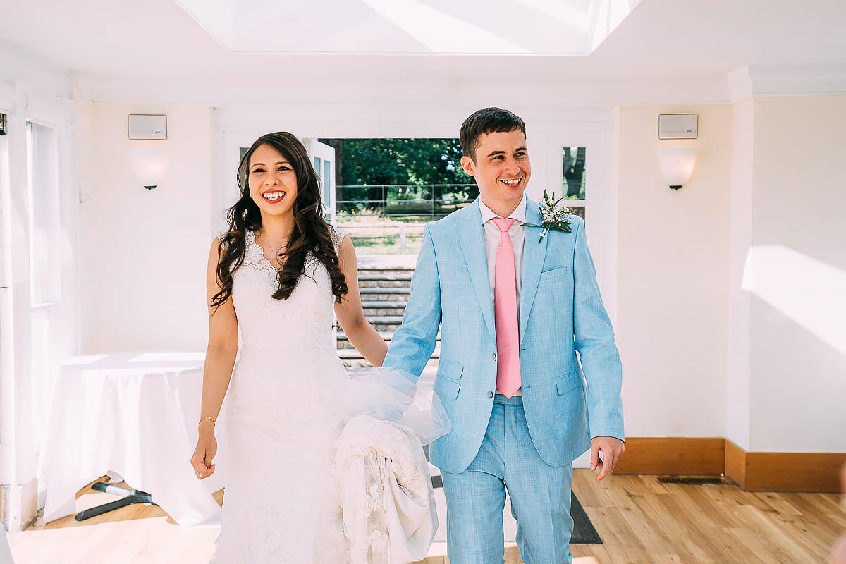 bride and groom enter belvedere suite