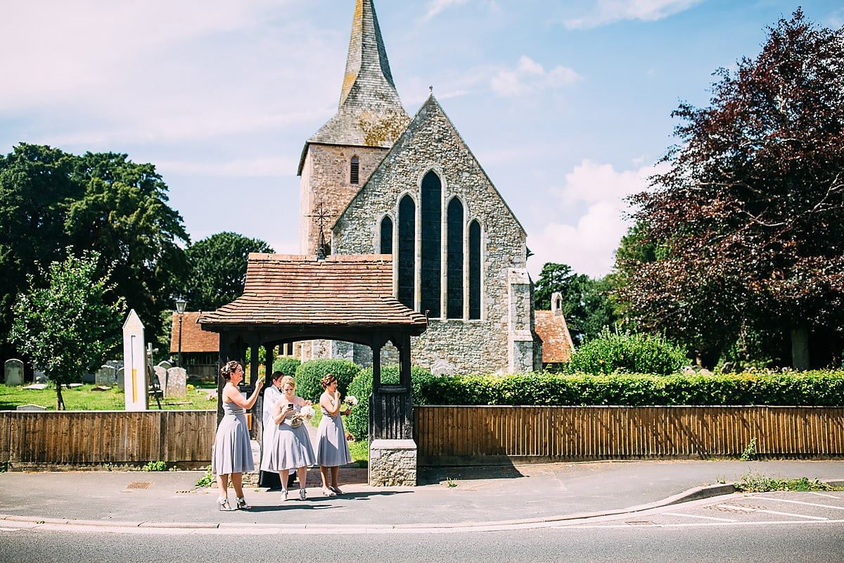 bridesmaids standing outside a church