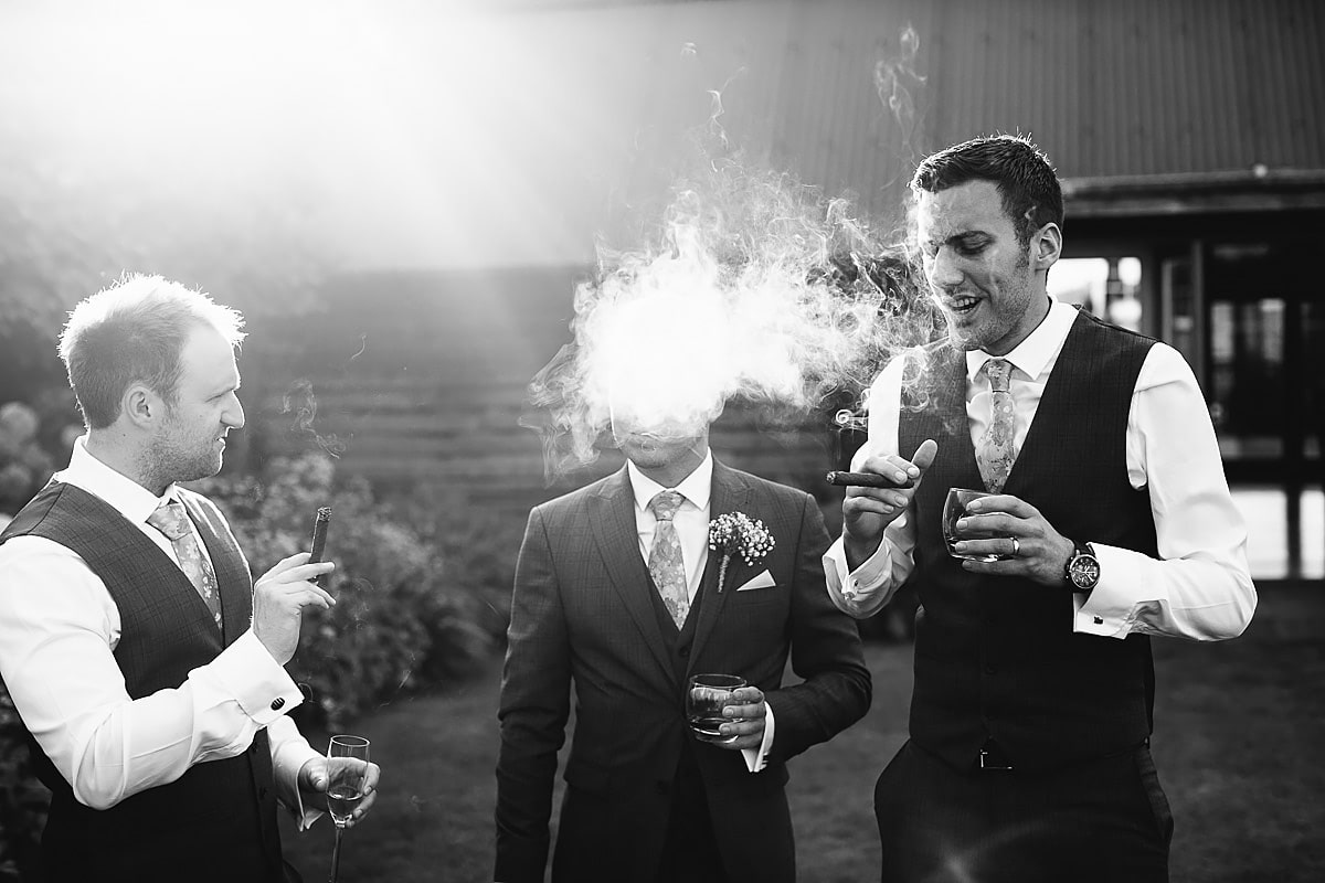 smoking cigars wedding