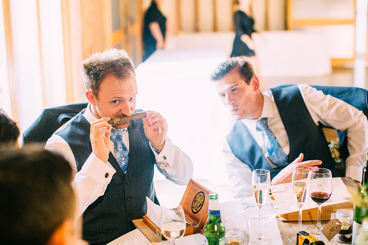 smelling a cigar at a wedding