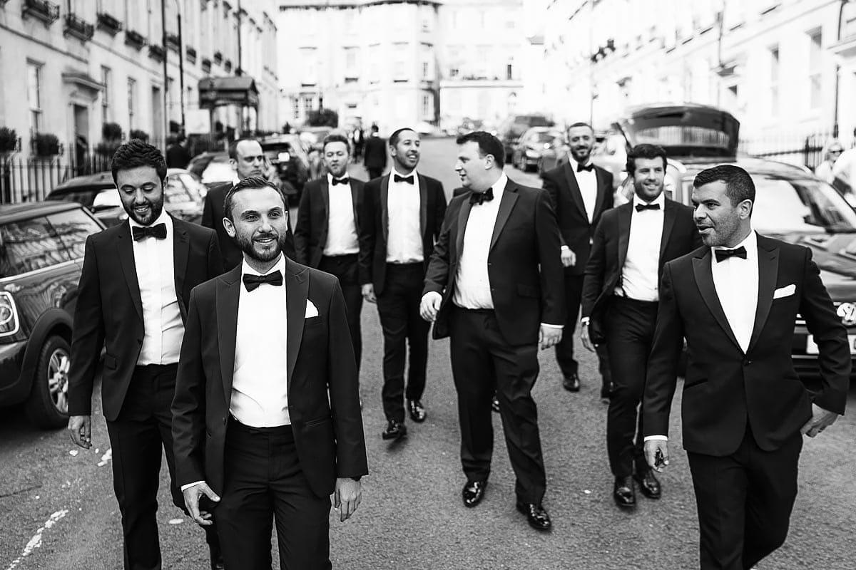 groom and groomsmen walking down there street