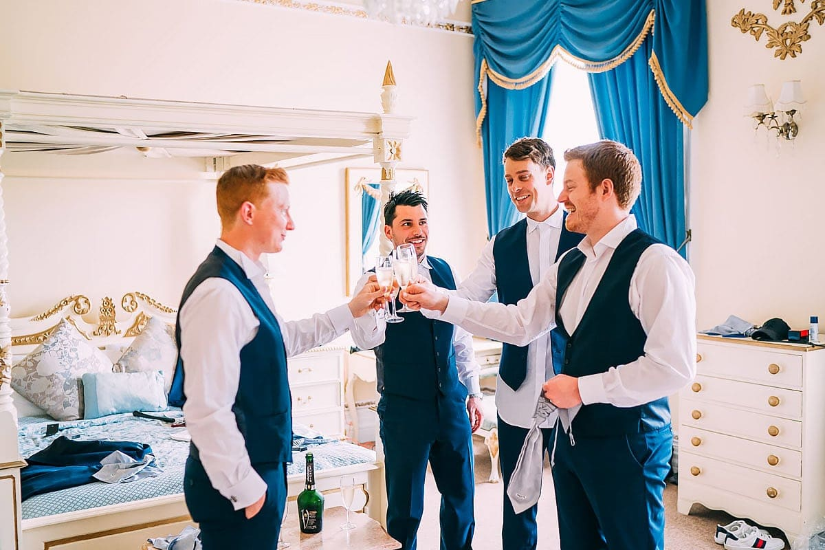 guys sharing a drink at wedding