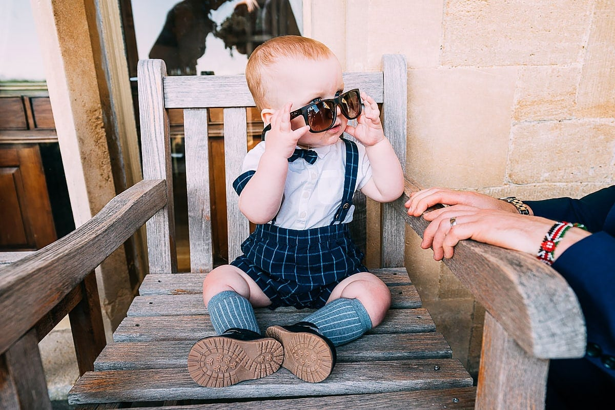 child and sunglasses at wedding