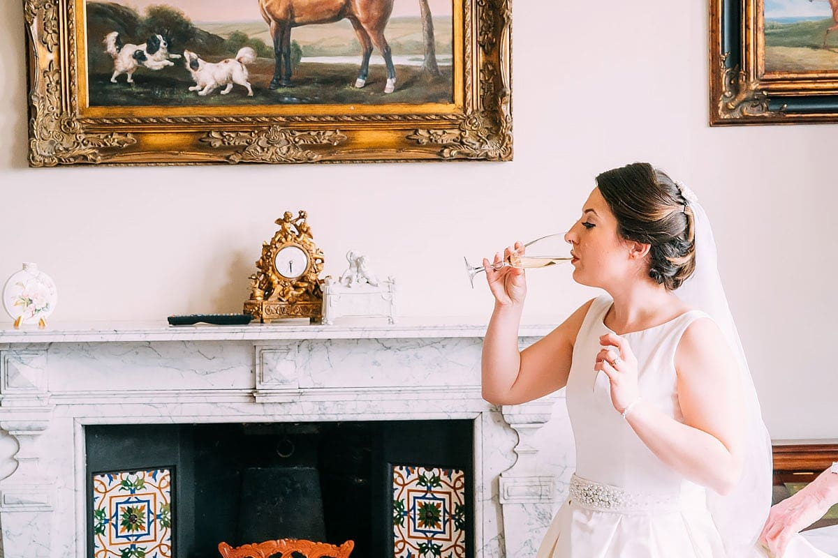 bride sipping a drink