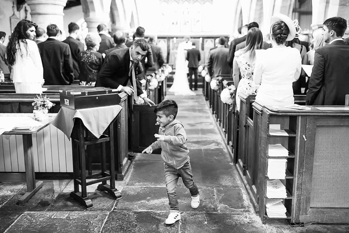 child running down church aisle