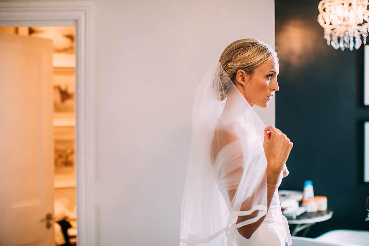 bride adjusting wedding veil