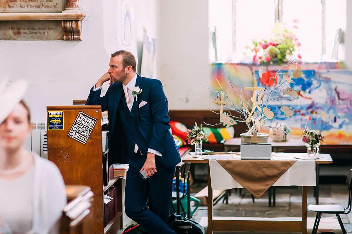 bored groomsman in church