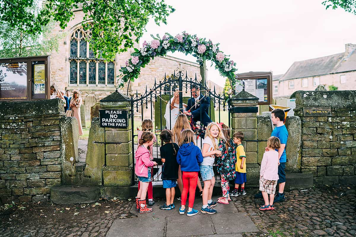 children waiting outside church tradition