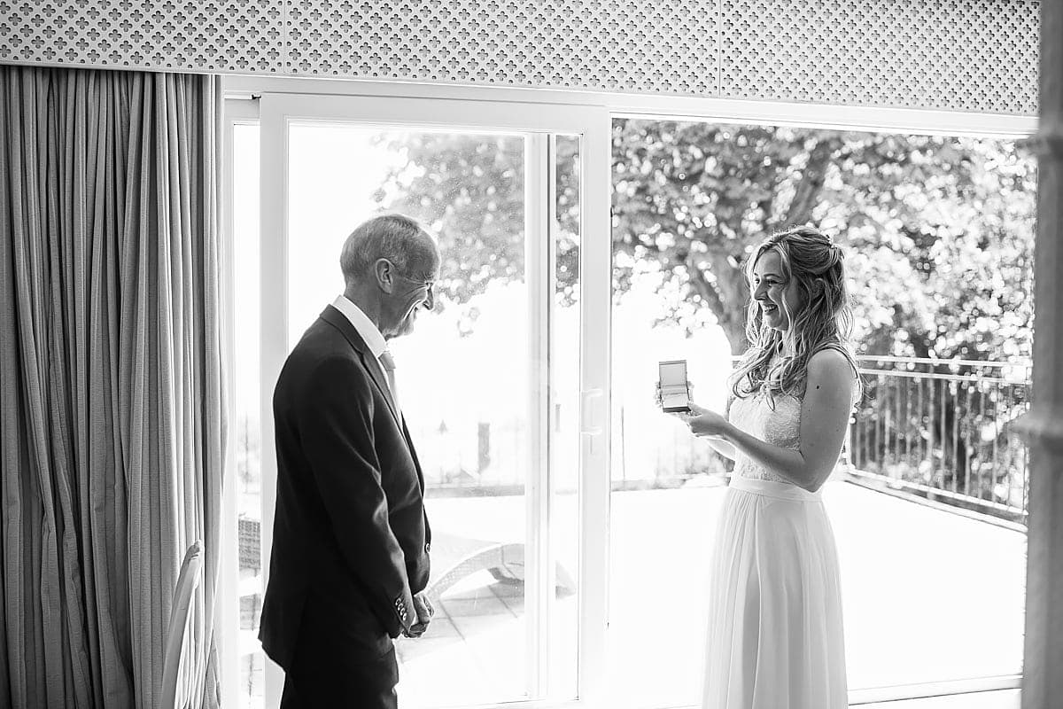 father of bride giving gift to bride