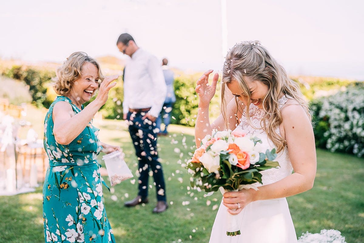 bride being covered in confetti