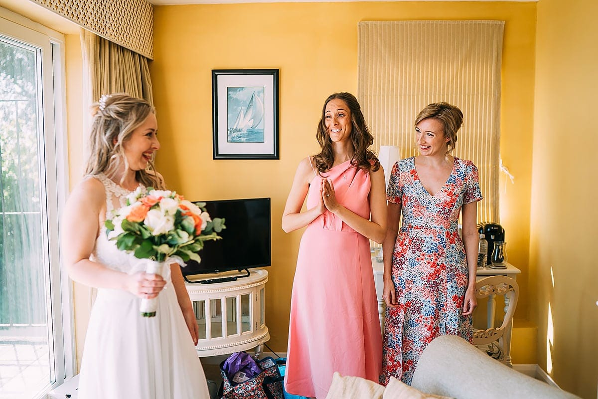 bride and friends getting ready for wedding